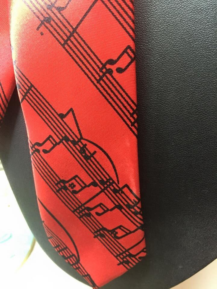 Red Tie with Black Musical Note Design